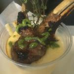 Grilled Lamb Chops with Black Truffle Cheese Grits and a Pesto Drizzle